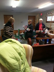 Getting ready for Chocolate Fest, December 6. Unpacking boxes of items.