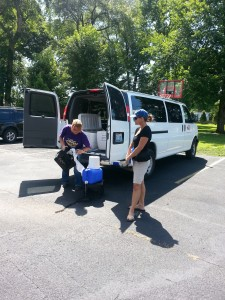 The KCEOC van bringing lunch to the children.  They are setting up a handwashing stand for the kids.